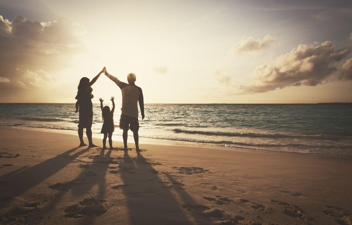 Family enjoying an activity on the beach
